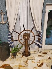 Antique solid bronze nautical ship steering station with functioning compass.