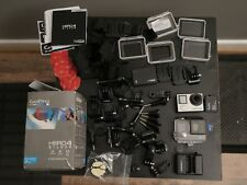 GoPro HERO 4 Silver With 64 GB Lexar MicroSD Card, Extended Battery, and extras