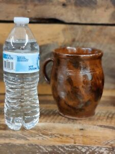 Antique redware tankard / mug with manganese splotches throughout pretty colors.