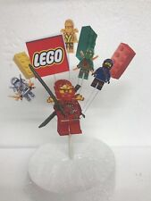 Lego Ninjago Happy Birthday cake topper display in a pick
