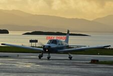 PHOTO  A SMALL AIRCRAFT ARRIVES AT OBAN AIRPORT JUST BEFORE SUNSET.