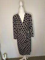 Jacqui E Flattering Black &  White Wrap Style Dress Size XL  Feature Metal Clasp