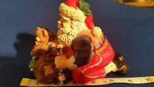 6 inches long x 4-1/2 inches tall, vintage resin Old World Santa Claus Figurine