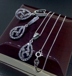 STUNNING STERLING SILVER 925 CZ ENCRUSTED PENDANT AND HUGGIE EARRINGS SET