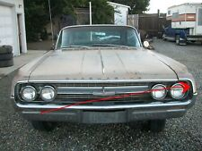 1964 OLDSMOBILE - LH GRILL EYEBROW - FENDER TRIM (WITH HIDDEN CRACK)