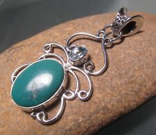 Sterling silver oval turquoise & cut blue topaz pendant. Gift bag.