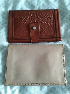 Used leather wallets two tan.colour.