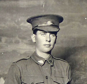 WW1 REAL PHOTO POSTCARD of a 1/AIF ANZAC SOLDIER BY DARGE PHOTOGRAPHER MELBOURNE