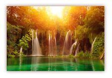 XXL Poster 100 x 70cm Wasserfall fliesst in wunderschön schimmernden Waldsee