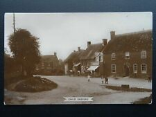 More details for dorset child okeford village shop (pre war memorial) old rp postcard w.h. diffey