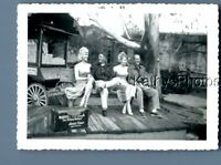 FOUND B&W PHOTO D_0608 MEN SITTING ON BENCHES WITH STATUES AT KNOTTS