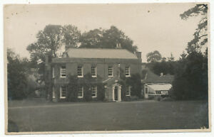 Unidentified large house with croquet lawn