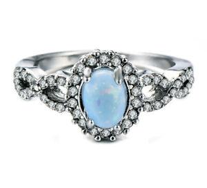 E08 078 Elegant Journey Ring Oval Fire Opal Blue Zirconia Silver Plated