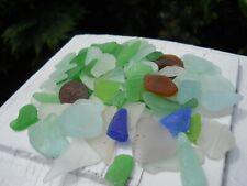 85 pieces of all natural sea glass. Aqua,sea foam,lime,green,blue,tinted,amber.