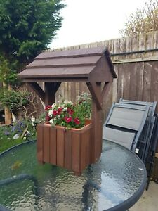 Wooden wishing well planter.