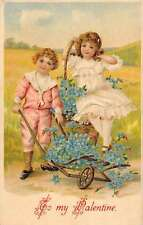 To My Valentine boy and girl with flowers in cart antique pc Y14388