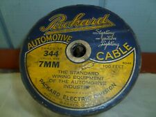 PARTIAL SPOOL OF VIN. PACKARD AUTOMOTIVE CABLE, SPARK PLUG WIRING.