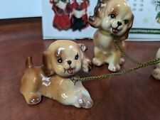 Ceramic Japanese brown mother dog and pups on chains.