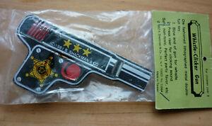 TINPLATE CLICKER GUN TIN TOY SHACKMAN BNIW 1980'S