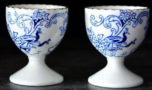 TWO BLUE & WHITE PEACOCKS PATTERN GILT-SCALLOPED EDGE EGG CUPS