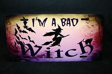 THE WITCH METAL NOVELTY LICENSE PLATE TAG FOR CARS    I AM A BAD WITCH