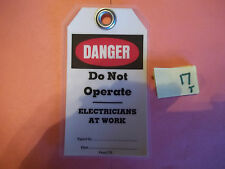 LOT OF 300 NEW DANGER DO NOT OPERATE ELECTRICIANS AT WORK SIGNS TAGS M1046? (Y4)
