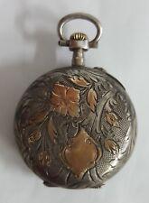 Año 1900. Reloj de Plata y Oro colgar o bolsillo. Maquina cilindro. 30 mm.