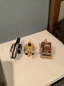 3 Small Dinotruxs.  Diecast.