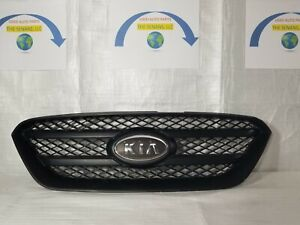 2010 Kia Rondo front grille with emblem.