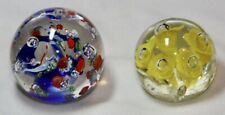 Two Glass Paperweights - Yellow Floral & Blue with Millefiori