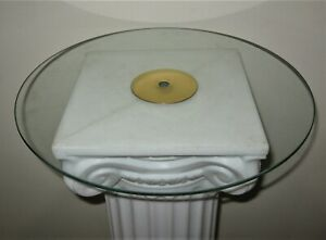Glass disk from tall stem floor lamp as cup counter book rest brass washer clear