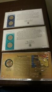 LOT OF 3 2000 US MINT COINS W CARDS SACAJAWEA GOLD DOLLAR 2 P-D US QUARTERS