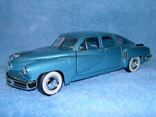 1/18 SCALE DIECAST 1948 TUCKER TORPEDO  IN METALLIC LIGHT BLUE BY YAT-MING.