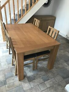 Oak kitchen table Extendable and four chairs. (Collection Only)