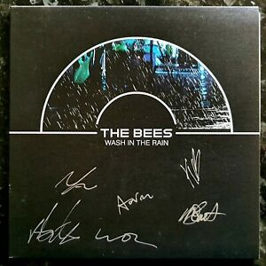 """The Bees - Wash In The Rain - New / Unplayed & Signed 2004 7"""" P/S"""