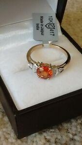 9k Gold Mandarin Garnet and White Zircon Ring