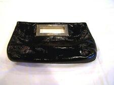 Michael Kors black clutch/purse/handbag with brass trim, signature lining