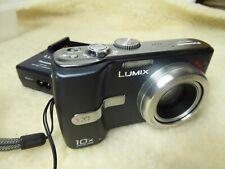 mint  Panasonic Lumix DMC-TZ1  + charger + new battery stunning camera