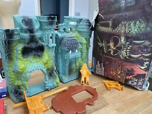 Vintage He Man Castle Greyskull and accessories with original box MOTU