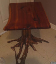 Handmade Red tint cedar wood table. Sanded, glossed and stood up with drift Wood