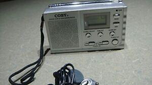 Avon 2005 Coby Digital AM FM Radio W/Alarm Clock & Ear Buds & Antenna NEW
