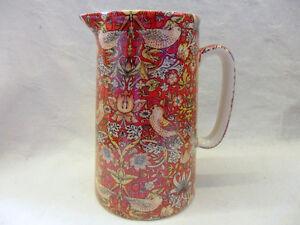 Heron Cross Pottery 2 pint jug in William Morris red birds tapestry design