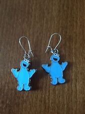 Silver Coloured Cookie Monster Themed Dangly Earrings - NEW