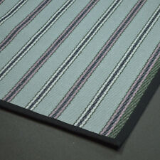 Striped flat weave wool rug. All sides edged in black cotton tape