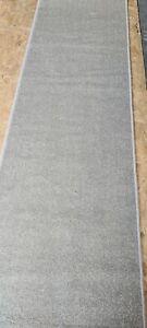 Carpet runner. Colour grey/beige. Size 450cms x 70cms. Unused.excellent quality.