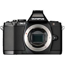 Olympus OM-D E-M5 16.1 MP Digital SLR Camera - Black (Kit w/ ED EZ 12-50mm Lens)