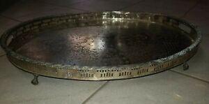 plateau ovale sur pieds de métal argenté signature