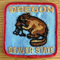"""OREGON - BEAVER STATE vintage cloth iron-on patch BEAVER GNAWING ON LOG, 3"""" x 3"""""""