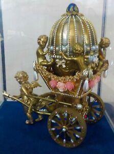 ANGEL PULLING CHARIOT WITH DECORATIVE EGG AND CHERUBS AFTER FABERGE?