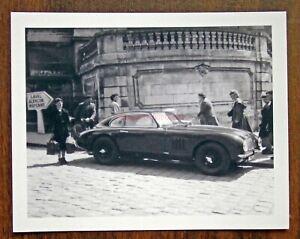 Racing car vintage photo. 1950 Aston Martin Team car on the streets of Le Mans